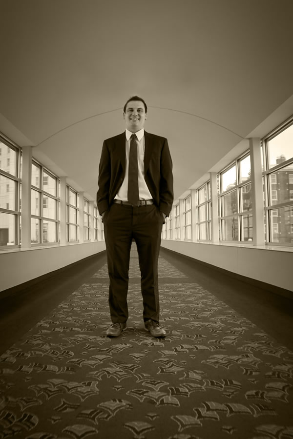 Picture of attorney Geoffrey J Lorenz standing in a hallway, ready to fight for you - whatever your criminal or traffic law needs