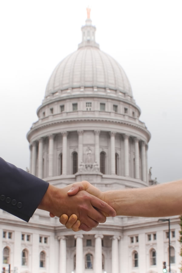 Picture of two people shaking hands on a business agreement