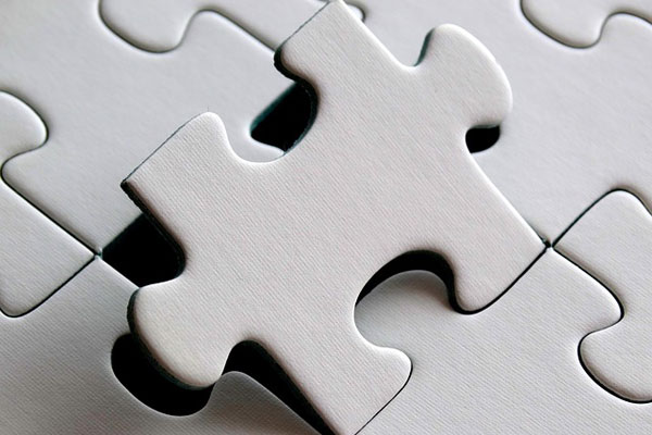 Business Planning - Picture of a puzzle piece being set into place