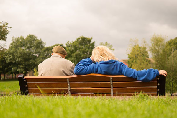 Estate Planning - Picture of an elderly couple sitting on a bench together